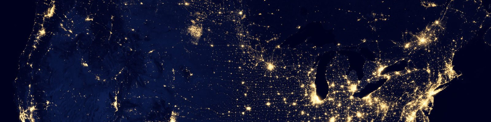 satellite view map of usa at night showing lights of states, cities and towns