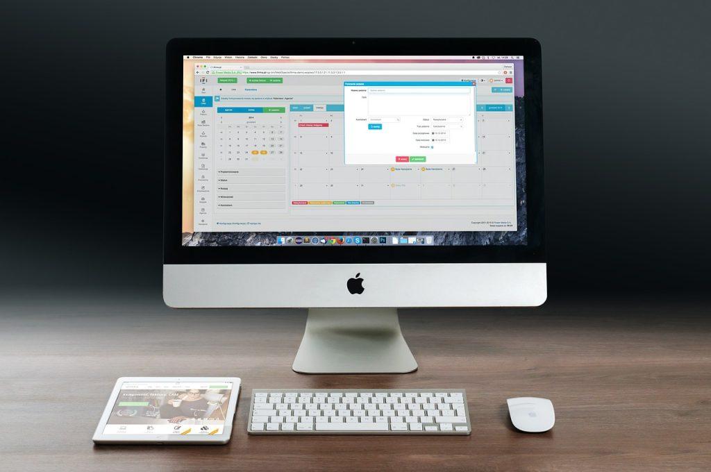 workplace productivity article - apple mac desktop computer with iCalendar app open