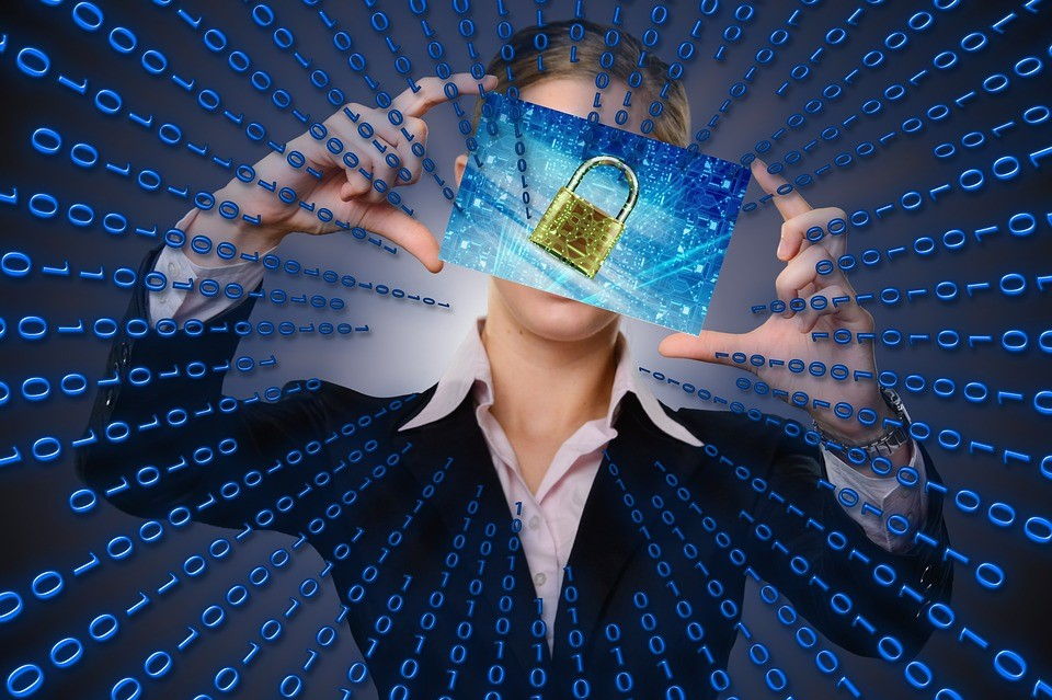 binary code leading to a padlock image being held up by a business woman