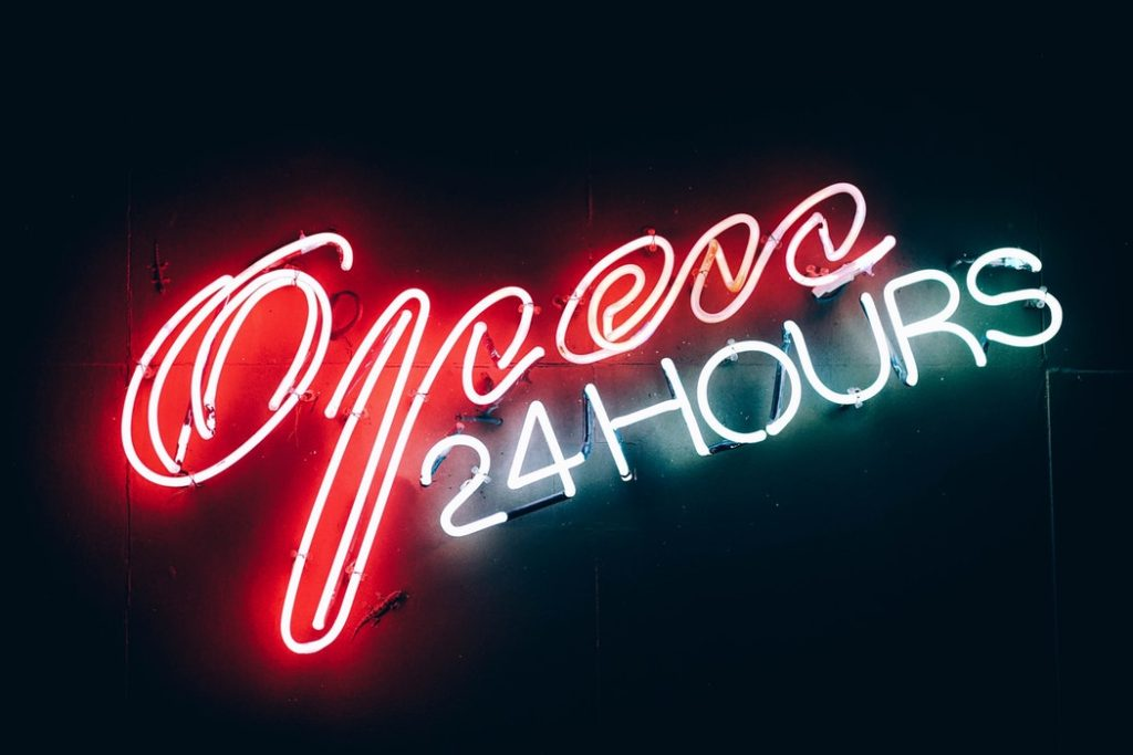 open 24 hours red and white neon sign