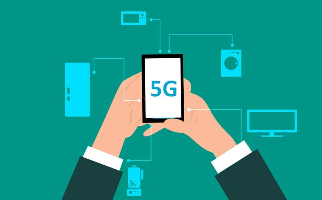 How will 5G Impact Mobile Payments - Man Holding 5G Compatible Mobile Smartphone