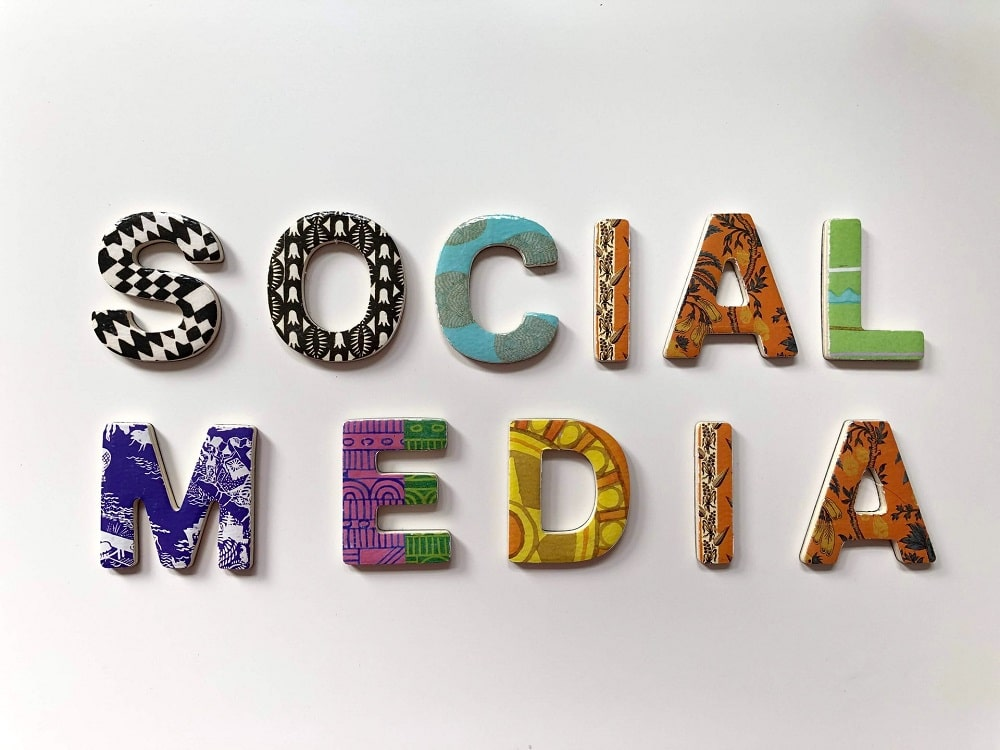 social media spelt out in different colored letters on white background