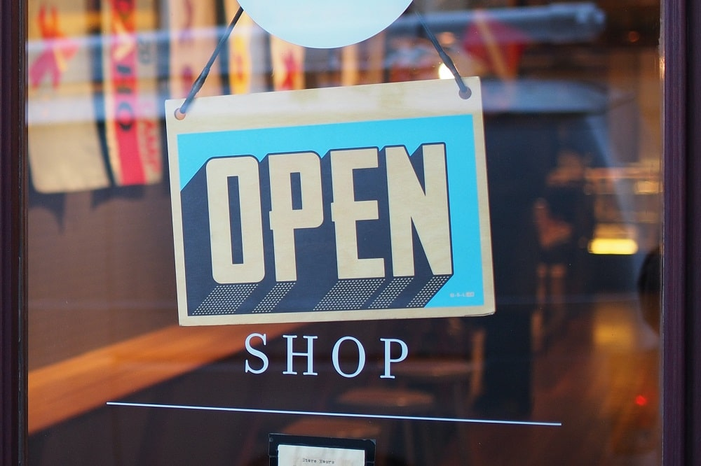 starting your business - 10 things to do - open shop sign in front window