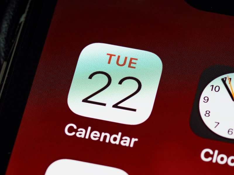 close up of iphone calendar integrates with scheduling software app