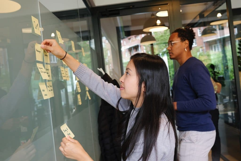 Generating SaaS business ideas - woman and man with post-it notes