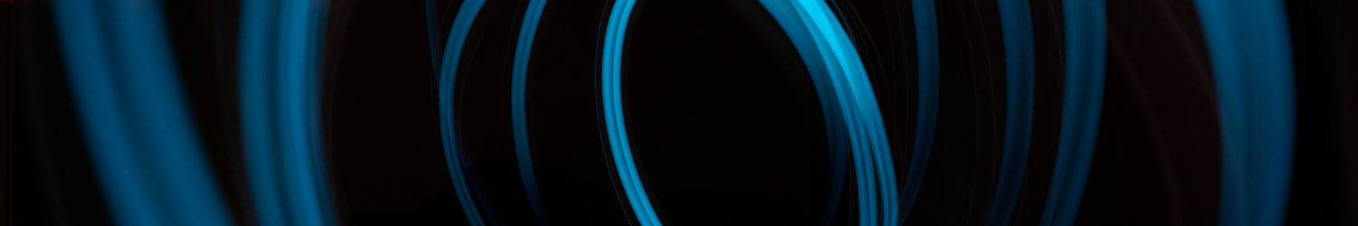 blue fiber optic lights swirling on black background