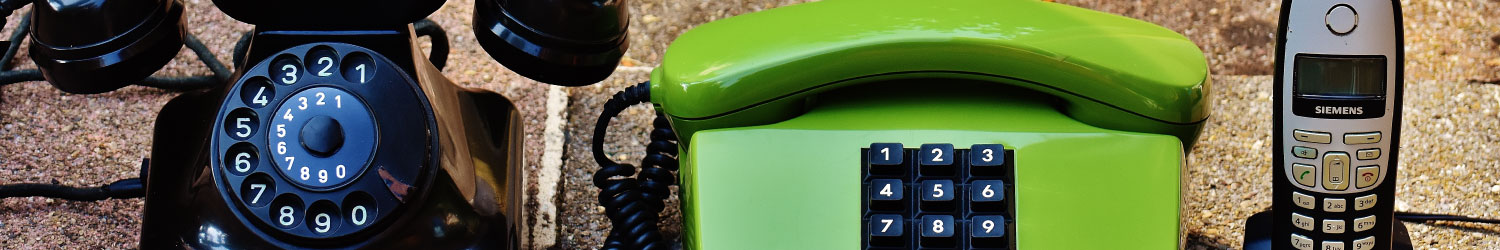 black vintage phone, retro green phone and modern siemens brand cordless phone comparison image